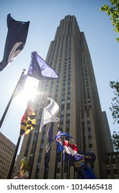 Manhattan, New York, May, 2017: waving flags in front of Rockefeller building Center with sunlight