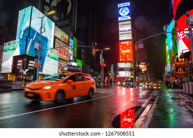 Manhattan, New York, NY, United States - October 27, 2018: Times Square during a rainy night.