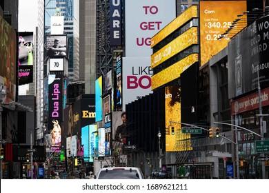 Manhattan, New York, NY / USA - March 31, 2020 : Broadway, Midtown Manhattan, empty streets due to outbreak pandemic CoronaVirus COVID-19