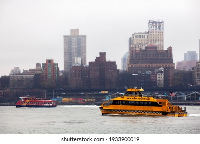 MANHATTAN, NEW YORK , USA - 29.12. 2015 : New York water taxi on tour with  Brooklyn coastline  on background. Rainy winter day