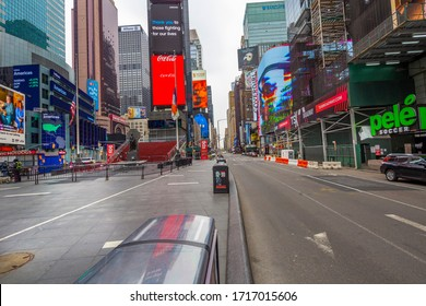 Manhattan. New York / USA - April 17, 2020: Empty streets of New York at Times Square 42nd street during pandemic virus Covid-19