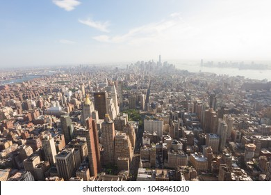 Manhattan, New York, USA -  May 27, 2015: Panoramic view of Lower Manhattan as seen from the Empire State Building observation deck in the late afternoon (New York, USA)
