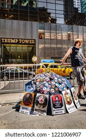 Manhattan, New York, USA - May 5, 2018: Street vendor selling anti Trump buttons in front of Trump towers on 5th Avenue, midtown Manhattan.