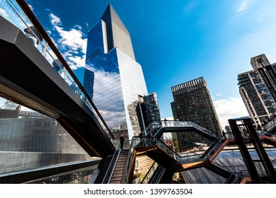 Manhattan, New York, USA - May 15th, 2019: New Yorkers and guests of the city are visiting Hudson Yards, with tis centerpiece TKA The Vessel, on a aunny spring day.