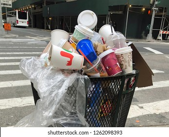 MANHATTAN, NEW YORK-DECEMBER 9, 2018:  An overflowing garbage bin full of trash in one of Manhattan's nicest neighborhoods.