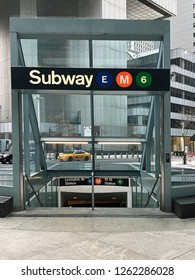 MANHATTAN, NEW YORK-DECEMBER 9, 2018:  Subway station entrance in front of a modern office building in midtown Manhattan, New York City