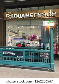 MANHATTAN, NEW YORK-DECEMBER 9, 2018: Subway station entrance in front of a Duane Reade pharmacy in midtown Manhattan, New York City