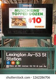 MANHATTAN, NEW YORK-DECEMBER 9, 2018:  Subway station entrance on Lexington Avenue in midtown Manhattan, New York City.  Image has a Dunkin Donuts advertisement above.