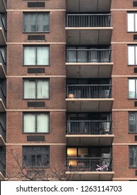 MANHATTAN, NEW YORK-DECEMBER 9, 2018:  Close-up of an upscale apartment or condominium building in mid-town on 2nd Avenue, featuring walk out balconies.
