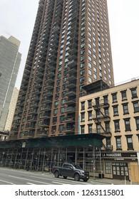 MANHATTAN, NEW YORK-DECEMBER 9, 2018:  Upscale apartment or condominium building in mid-town on 2nd Avenue. Restaurant La Mangeoire is next door.