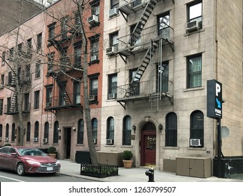 MANHATTAN, NEW YORK-DECEMBER 9, 2018:  Vintage brownstone walk-up apartments on a residential street in midtown Manhattan.