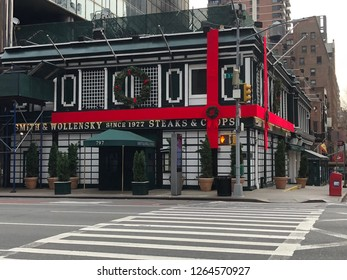 MANHATTAN, NEW YORK-DECEMBER 9, 2018:  Exterior of the original Smith & Wollensky steakhouse, decorated with a huge red holiday bow.  It is located at the corner of 3rd Avenue and 49th Street.