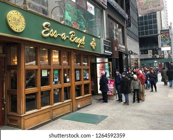 MANHATTAN, NEW YORK-DECEMBER 9, 2018:  A line forms outside of Ess-a-Bagel as customers wait their turn for fresh, hot bagels.