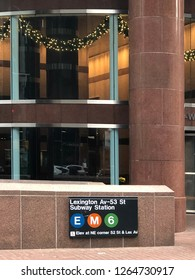 MANHATTAN, NEW YORK-DECEMBER 9, 2018:  Modern entrance to the Lexington Avenue subway station, in front of a new office tower.
