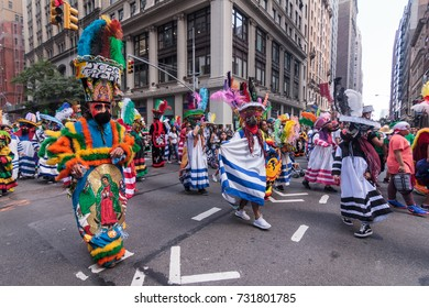 MANHATTAN, NY (09/17/2017) - Mexican Day Parade with people marching on Madison Avenue in Midtown East.