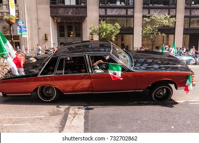 MANHATTAN, NY (09/17/2017) - Mexican Day Parade with people driving in a car on Madison Avenue in Midtown East.