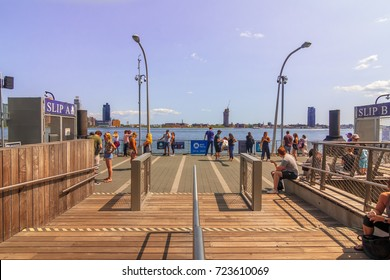 MANHATTAN, NY (August 26, 2017) - People waiting at the NYC Ferry Service by East 34th Street/East River in the afternoon.