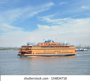 MANHATTAN, NY  - JUL 8: The Staten Island Ferry a municipal service since 1905 (it began in 1817), currently carries over 21 million passengers annually on the 5.2-mile (8.4 km) run. NYC Jul 8, 2103.