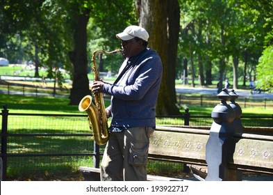 MANHATTAN, NY- SEPTEMBER 21: Performer at Central Park in New York, USA on September 21, 2013. One of the 5 boroughs of New York City, the smallest but also the most populated.