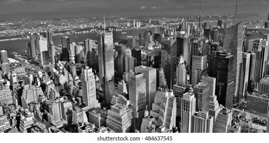 Manhattan, NY, USA - October 13, 2015: Midtown Manhattan, on the west side of the city with Times Square in the foreground and the Hudson River in the background.