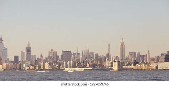 Manhattan panorama at sunset, color toned picture, New York City, USA.