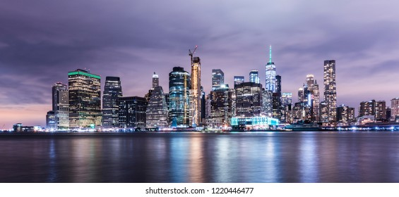 Manhattan panoramic skyline at night. New York City, USA. Office buildings and skyscrapers at Lower Manhattan (Downtown Manhattan).
