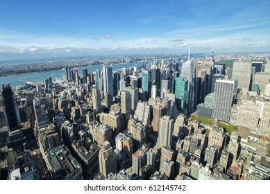 Manhattan panoramic view on a sunny day, skyscrapers seen from above