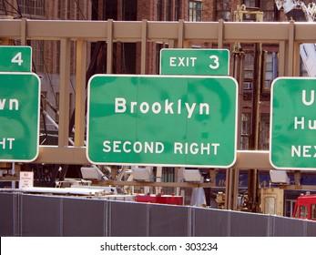 Manhattan Sign Series - Brooklyn, New York City. A sign directs traffic to Brooklyn, New York City