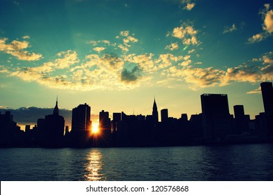 Manhattan silhouette skyline at sunset