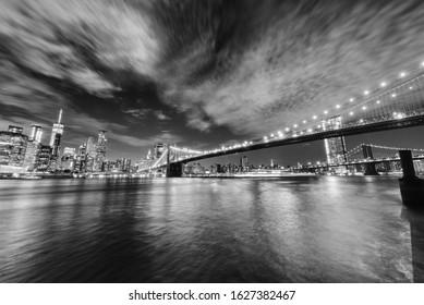 Manhattan skyline and Brooklyn Bridge by night . - Shutterstock ID 1627382467