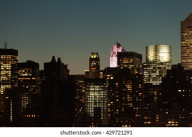 Manhattan skyline detail with skyscrapers during twilight in New York City, USA.