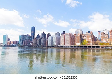 Manhattan skyline and East River. Lower East Side of Manhattan waterfront in New York city.