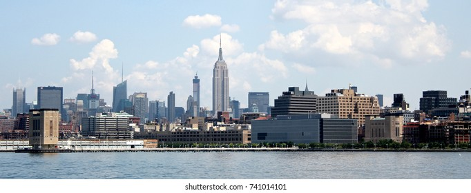 Manhattan Skyline with Empire State Building over Hudson River, New York City, USA, August 8, 2017