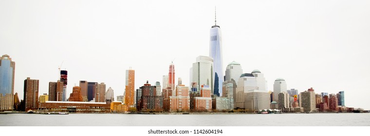 Manhattan skyline with freedom tower from hudson river at bright day