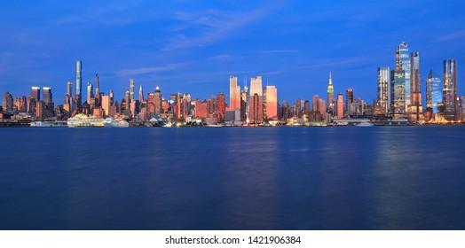 Manhattan skyline in New York City reflected in Hudson River, USA