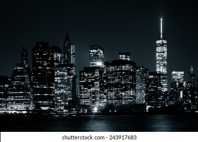 The Manhattan Skyline at night, seen from Brooklyn Bridge Park, Brooklyn, New York.