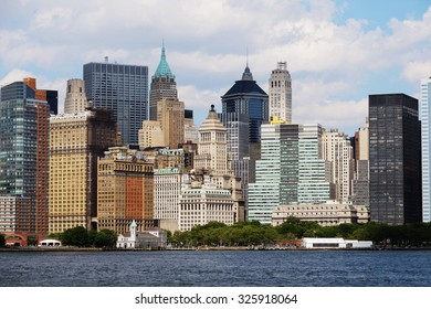 Manhattan skyline over Hudson River, New York, USA. Manhattan downtown view with skyscrapers, NYC panorama. Top of the buildings in financial district. Business background. NY skyscrapers.