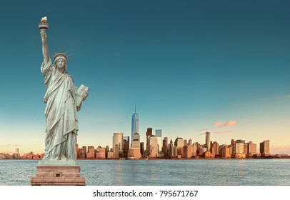 Manhattan Skyline with the Statue of Liberty in foreground, New York City. USA