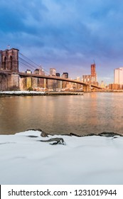 Manhattan Skyline sunrise as seen from Pebble Beach in Brooklyn, New York, United States of America.