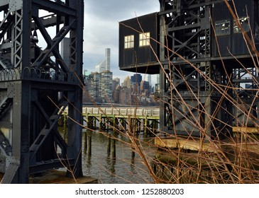 Manhattan skyline with wooden pier and  vintage rail gantry in foreground, harking back to the industrial era of vintage New York