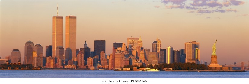 Manhattan skyline with World Trade Center and Statue of Liberty in New York City, NY