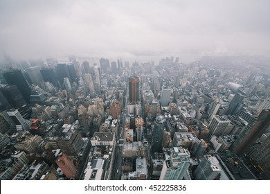 Manhattan top view in rainy day with clouds.