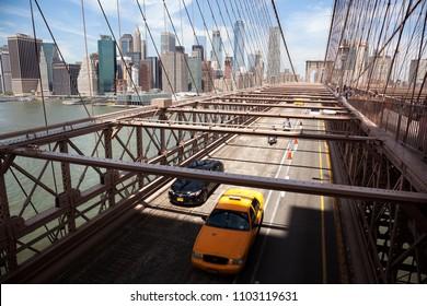 MANHATTAN, USA-9 June , 2017: Crossing the Brooklyn bridge towards manhattan on a sunny day on June 9, 2017