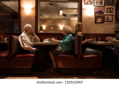 MANHATTAN, USA-June 10, 2017: An old couple having dinner in a typical bar in the USA, Manhattan on June 10, 2017