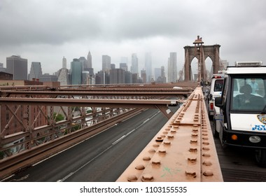 MANHATTAN, USA-JUNE 6, 2017: Crossing the Brooklyn bridge towards manhattan covered by fog on June 6, 2017