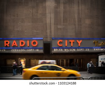 MANHATTAN, USA-June 6, 2017: A taxi passes through the back of the City hall oin Manhattan on June 6, 2017