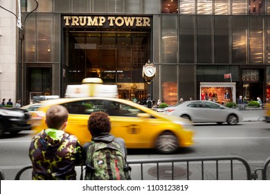 MANHATTAN, USA-JUNE 6, 2017:Two children watching the entrance of the Trump building. Current president of the United States of America on June 6, 2017