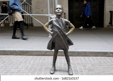 "Manhattan,New York/United States-Dec 22 2019:""The Fearless Girl""Statue in front of New York Stock Exchange in Lower Manhattan,New York City.United States."