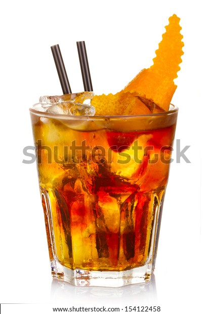 Manhatten alcohol cocktail with orange fruit rind isolated on white background