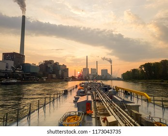 Manheim Germany September 2018, inland shipping gas tanker sailing on the Rhine river with low water gas tanker during sunrise